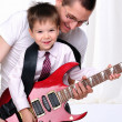 Young father teaches his young son - Photo