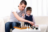 Dad and son playing chess — Stok fotoğraf