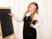 Little girl wrote a white chalk — Stock Photo