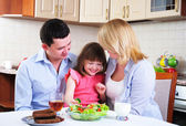 Dad, Mom and their little daughter — Stock Photo
