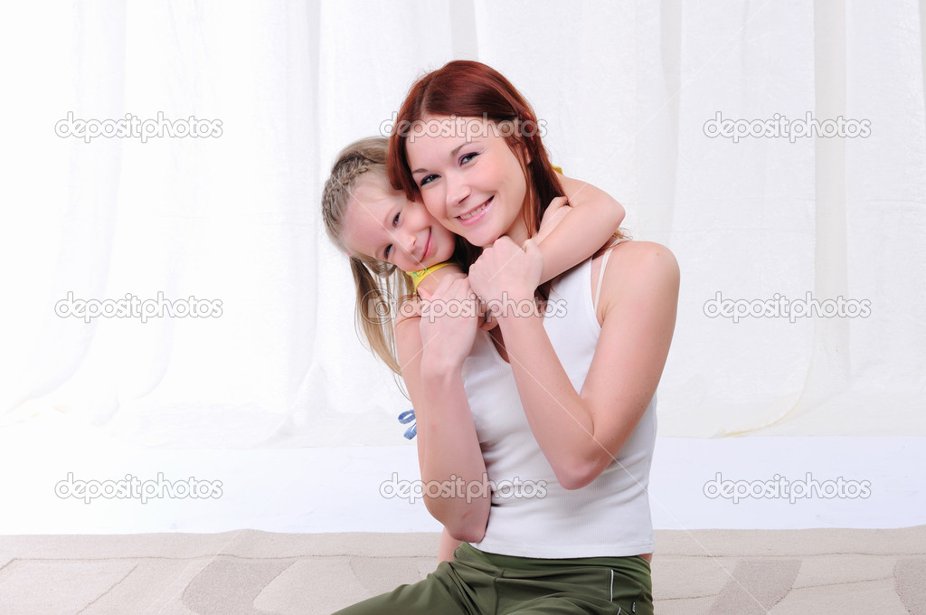Young mother and daughter spend time together  Stock Photo #4488115