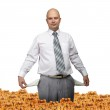 Bald young businessman with a small coin — Stock Photo