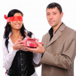 Young man gives his girlfriend a gift — Stock Photo