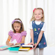 Little girls are studying literature — Stock Photo
