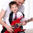Royalty-Free Stock Photo: Young father teaches his young son