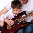 Young father teaches his young son — Stock Photo #4505030