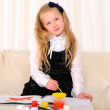 Little girl draws paint — Stock Photo #4505076