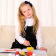 Little girl draws paint — Stock Photo
