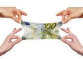 Several hands stretch of banknotes — Stock Photo