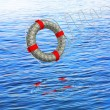 Stock Photo: Lifebuoy white against the blue sea