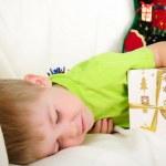 Little boy fell a sleep on the couch — Stock Photo #4510904