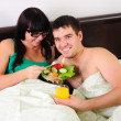 Stock Photo: Young couple at breakfast