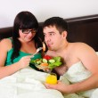 Young couple at breakfast — Stockfoto