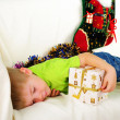 Stock Photo: Little boy fell sleep on couch