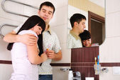 Young couple together to wash in the bathroom — Stock Photo
