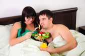 Young couple at breakfast — Stock Photo
