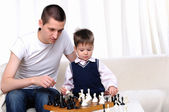 Dad and son playing chess — Stock Photo