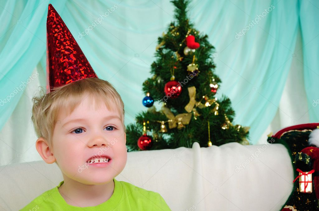 Little boy getting ready for the holiday. Happy New Year and Merry Christmas!  Stock Photo #4510913