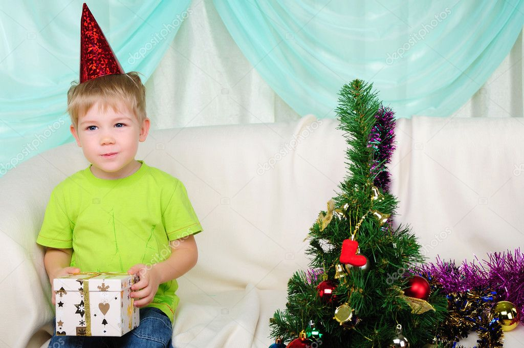 Little boy getting ready for the holiday. Happy New Year and Merry Christmas! — Stock Photo #4510976