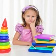 Foto Stock: Little girl is studying literature