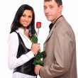 Young man gives his girlfriend a rose — Stock Photo #4525915