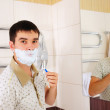 Young man shaving in the morning — Stock Photo #4527038