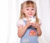 Little girl in blue dress — Стоковое фото