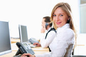 Young girl in his office — Stock Photo