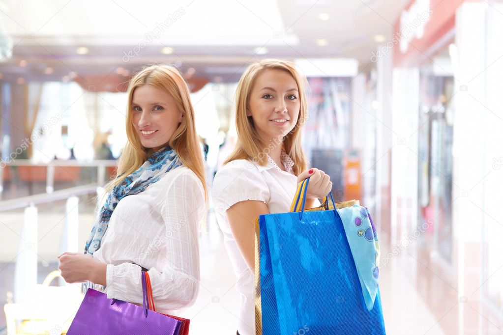 Two young beautiful girls are engaged in shopping in a store  Stock Photo #4521056