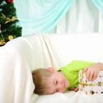 Little boy fell a sleep on the couch — Stock Photo #4539986
