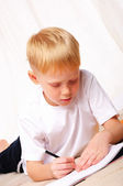 Little boy draws — Stock Photo