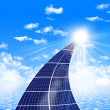 Road from the solar panels - Stock Photo