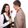 Young man gives his girlfriend a rose - Photo