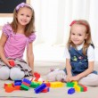Two little girls play - Stock Photo
