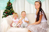 Young mother and her two children — Stock Photo