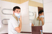 Young man shaving in the morning — Stock Photo