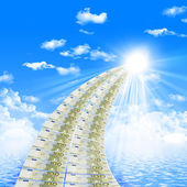 Road from banknotes disappearing into a bright blue sky. — Stock Photo