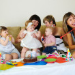 Mothers and their children gathered together - Stock Photo