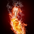 Hands with keys in open fire — Stock Photo