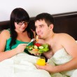 Young couple at breakfast — Stock Photo #4567330