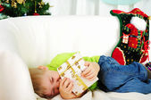 Little boy fell a sleep on the couch — Stock Photo