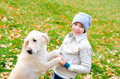 Boy playing in autumn park — Stock Photo