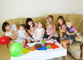 Mothers and their children gathered together — Stock Photo