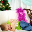 Little boy fell a sleep on the couch - Stock Photo