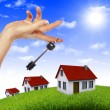 House in the hands against the blue sky — Stock Photo