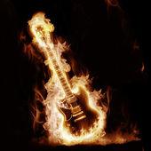 Electronic guitar enveloped flames — Stock Photo