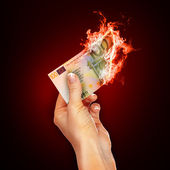 Banknotes open arms fire — Stock Photo