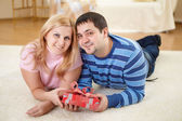 Man at home with a present — Stock Photo