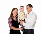 Мать, отец и их ребенок вместе в студии — Стоковое фото