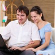 Royalty-Free Stock Photo: Young family at home with a laptop